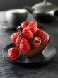Small chocolate cake with raspberries to serve with tea