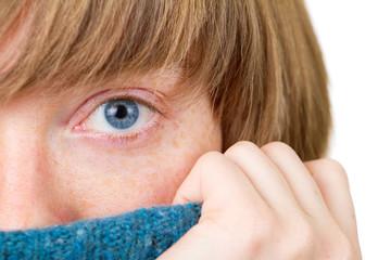 Blue eye closeup shot. Winter portrait of a young woman