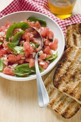 Tomato salsa with basil, grilled white bread, olive oil