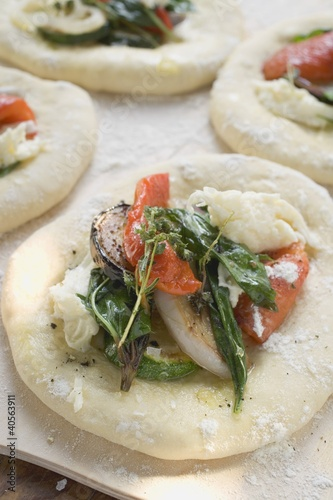 Focaccia topped with vegetables and basil