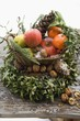 Christmas decoration: fruit, nuts, cones and box wreath