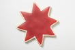 A star cookie with red icing