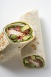 Two wraps filled with chicken and avocado