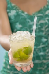 Woman holding glass of Caipirinha