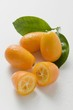 Several kumquats with leaves