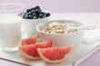Muesli ingredients: cereal, yoghurt, blueberries, grapefruit
