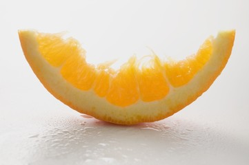 Wedge of orange, partly eaten