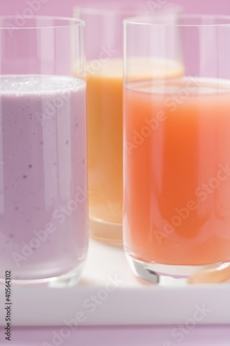Blueberry milk and two different juices