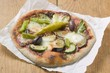 Pizza topped with courgette, aubergine, chilli and olives