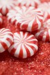 Peppermints on red sugar