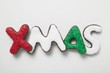 Iced chocolate letters (the word 'XMAS)