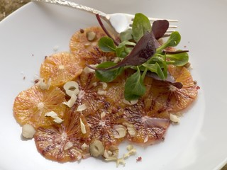 Orange carpaccio with corn salad (overhead view)