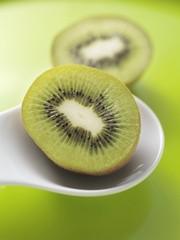 Two halves of a kiwi fruit