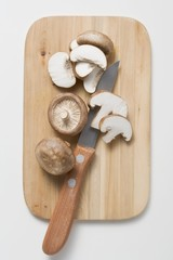 Shiitake mushrooms with knife on chopping board