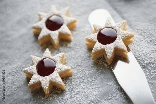 Three jam biscuits with icing sugar