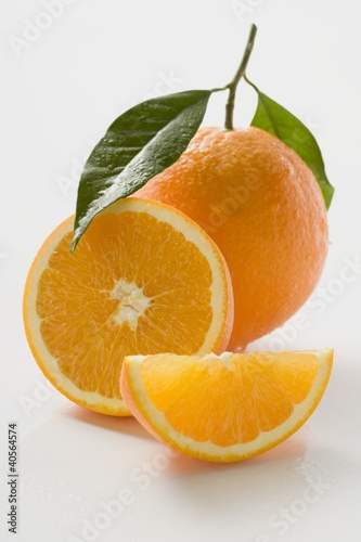 Orange with stalk and leaf, orange half and wedge