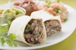 Bean burritos with accompaniments (Mexico)