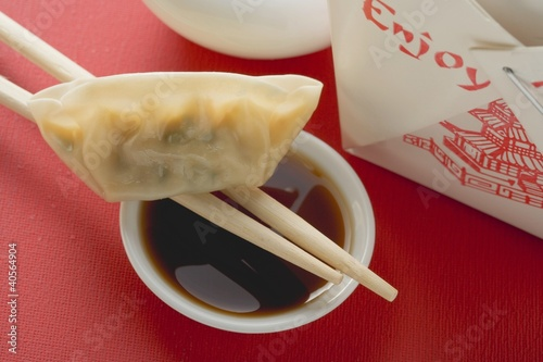 Dim sum with chopsticks and dip to take away (Asia)
