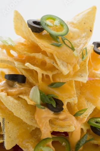 Nachos with cheese, olives and chilli rings