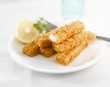 Fish fingers with lemon on plate