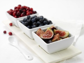 Fresh figs and berries in dishes