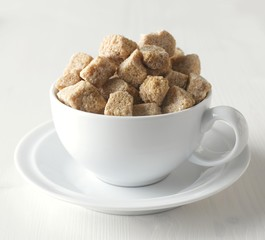 Brown sugar cubes in cup