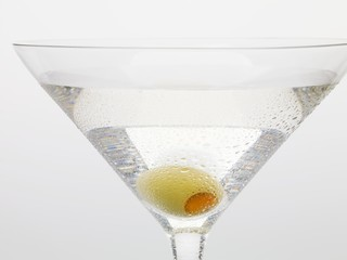 Martini with green olive (close-up)