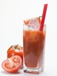 Tomato drink with ice cubes, fresh tomatoes