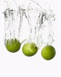 Three limes falling into water