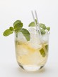 Mojito with mint, ice cubes and straws