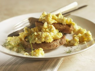 Scrambled Eggs Over Wheat English Muffin