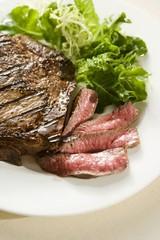Partially Sliced Steak; Rare; Side Salad