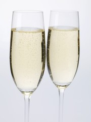 Two glasses of sparkling wine side by side