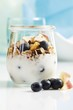 Yoghurt with muesli, blueberries, apple and dried fruit