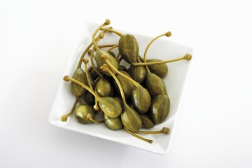 Giant capers in square dish