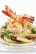Fried prawns on potato, asparagus and ham salad