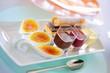 Coffee dessert with crème brûlée, fruit sauce and pastries
