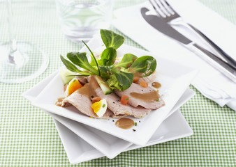 Veal with salad and balsamic dressing