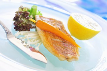 Fried red snapper with carrot and enoki mushrooms