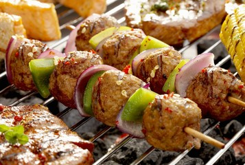Meat, onion and pepper kebabs on barbecue
