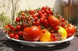 Large Platter of Various Tomatoes on Outdoor Table