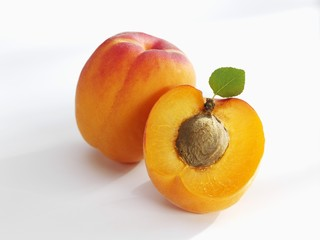 Whole and half apricot