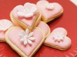 Pink heart-shaped biscuits with sugar flowers