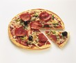 A salami and pepper pizza with olives, a slice cut