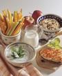 Muesli, vegetable sticks and dips for breakfast