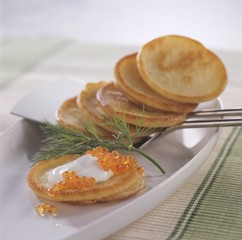 Blinis with sour cream and caviar