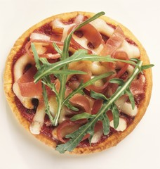 A small ham and mozzarella pizza with rocket