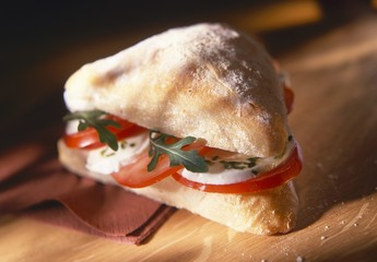 Tomatoes, mozzarella and rocket in ciabatta