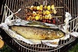 Barbecued trout with mushroom and potato skewers
