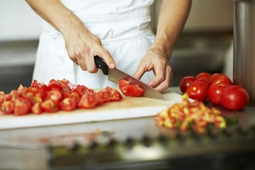 Chef chopping tomatoes